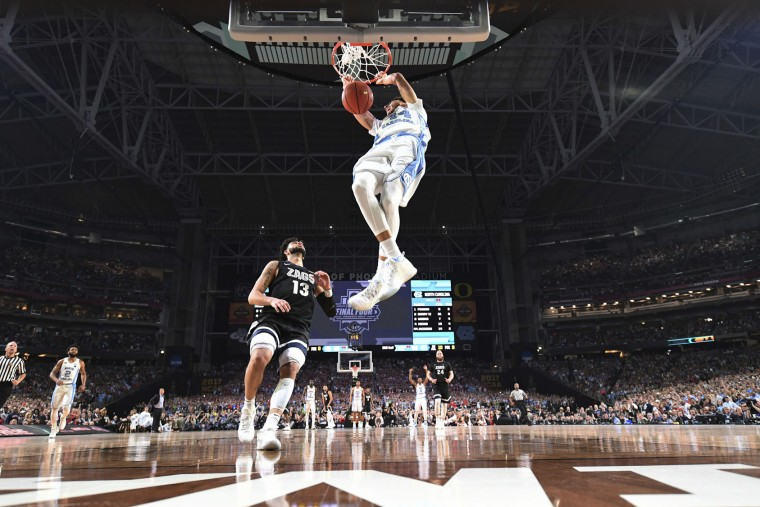 North Carolina's Justin Jackson dunks over Gonzaga's Josh Perkins (13) during the second half in the finals of the Final Four NCAA college basketball tournament, Monday, April 3, 2017, in Glendale, Ariz. (AP Photo/Chris Steppig, Pool)