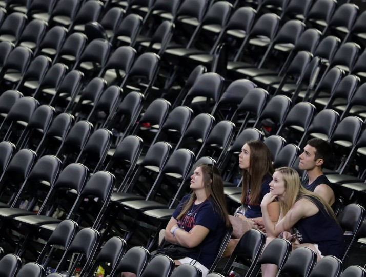 Gonzaga sit in the stands after the championship game against North Carolina at the Final Four NCAA college basketball tournament, Monday, April 3, 2017, in Glendale, Ariz. North Carolina 71-65. (AP Photo/Matt York)