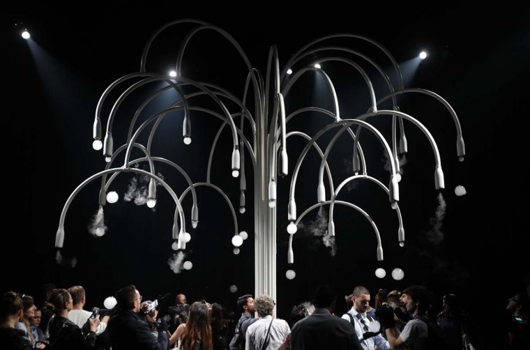 "People visit an installation called ""New Spring"" by Studio Swine for Cos' furniture designers, part of the Design Fair exhibition in Milan, Italy, Thursday, April 6, 2017. It is a multi-sensory installation. (AP Photo/Antonio Calanni)"
