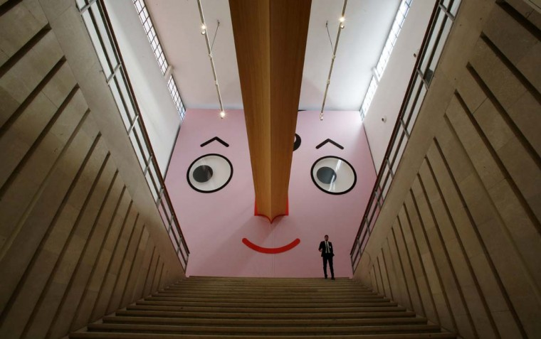"A man walks at the entrance of ""Giro Giro Tondo design for children"" exhibition, at the Triennale museum, in Milan, Italy, Monday, April 3, 2017. The Milan Design week is taking place in various locations across Milan from April 4 through 9, 2017. (AP Photo/Antonio Calanni)"