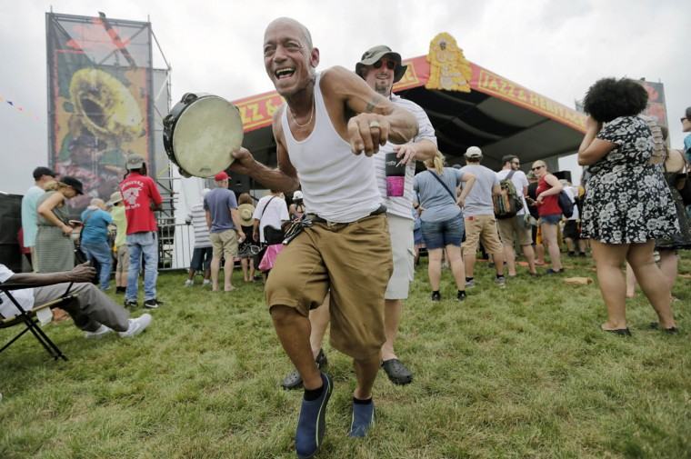Allen Pazon dances in front of the Jazz and Heritage Stage during the New Orleans Jazz and Heritage Festival at the Fair Grounds in New Orleans on Friday, April 28, 2017. (Brett Duke/NOLA.com The Times-Picayune via AP)