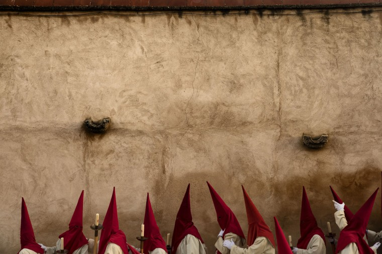 Penitents from 'Real Cofradia del Santisimo Cristo de las Injurias' also known as 'El Silencio' brotherhood take part in a procession in Zamora, Spain, on Wednesday, April 12, 2017. Hundreds of processions take place throughout Spain during the Easter Holy Week. (AP Photo/Daniel Ochoa de Olza)