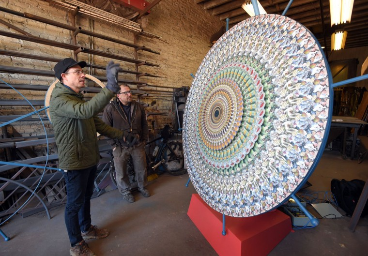 """Baltimore,MD--3/23/17 - Light City Baltimore installation by Eric Dyer called, """"Shabamanetica"""". It's an animated piece that uses a strobe light. He is pictured with Tim Scofield who is helping him with the construction with the piece. (Lloyd Fox/Baltimore Sun)"""