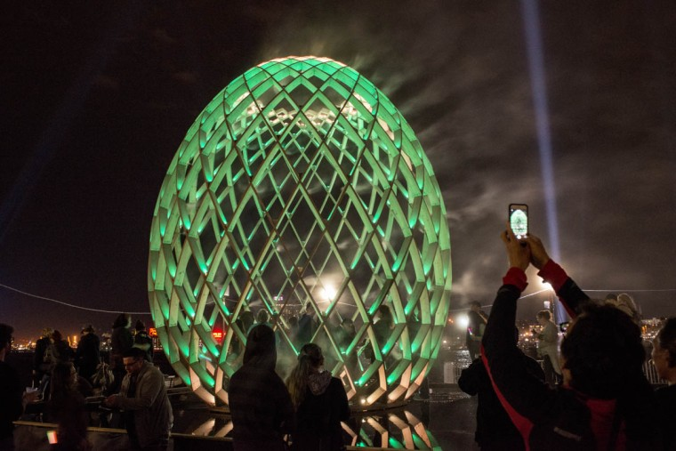 A visitor take a photo of OVO, a multi-sensory art installation at Light City Baltimore on Wednesday, April 5, 2017. (Emma Harris, Baltimore Sun)