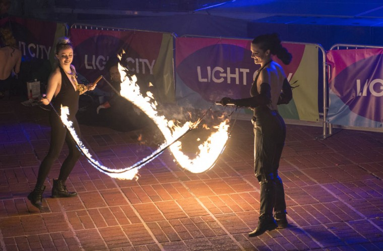 Two performers with PYROXOTIC, an all-female performance troupe, use ropes lit on fire to create a jump-rope during Light City Baltimore on Wednesday, April 5, 2017. (Emma Harris, Baltimore Sun)