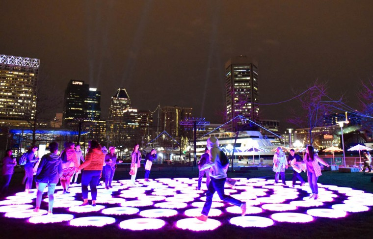 "Visitors to the Inner Harbor got a sneak peek at some of the Light City installations Thursday night including ""The Pool"" by Jen Lewin. Light City officially opens Friday night. (Jerry Jackson, Baltimore Sun)"
