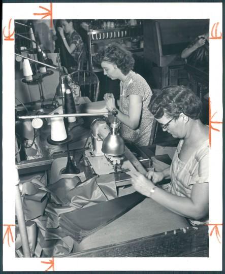 Sewing umbrellas at Polan Katz & Co., December 13, 1953. (Baltimore Sun)