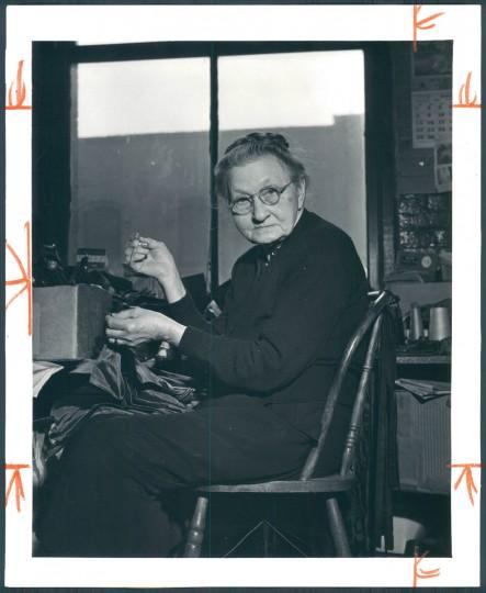 Woman works at Polan Katz & Co., December 13, 1953. (Baltimore Sun)
