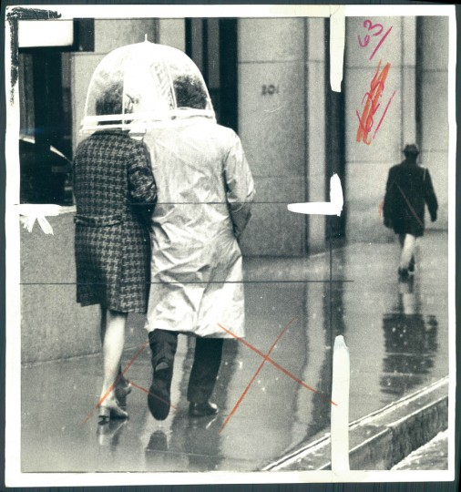 Couple with umbrella in photo dated March 28, 1974. (Baltimore Sun)