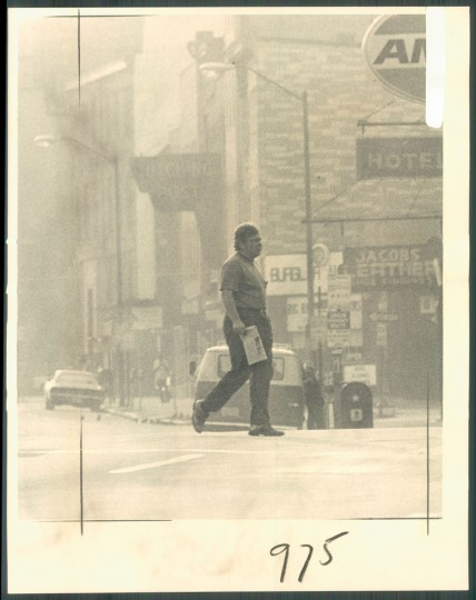 Visibility Poor: Baltimore's bad air conditions have caused a pollution alert to be sounded and it remains in effect for the weekend. The scene here is East Baltimore street and Market place. Photo dated June 12, 1976. (Swagger/Baltimore Sun)