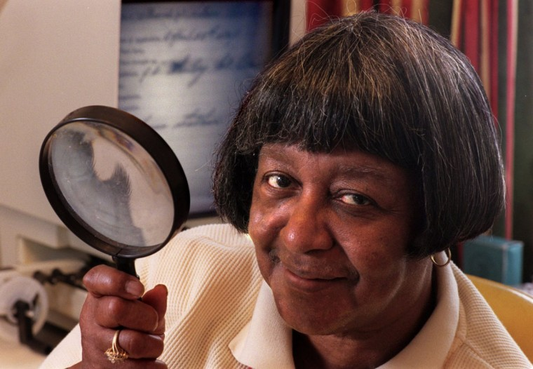 BALTIMORE, MD - February 4, 1999 - Staff/Amy Davis -- Agnes Kane Callum, the dean of African-American genealogists, at home in Northeast Baltimore, where she does research on Maryland black history. She uses a magnifying glass to decipher documents on her microfilm reader, which is behind her.