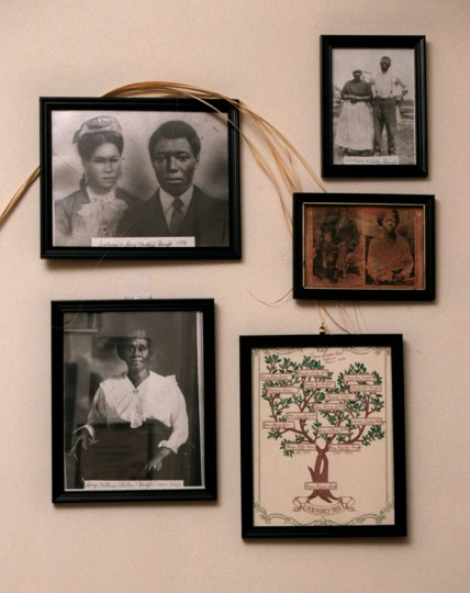 BALTIMORE, MD - February 4, 1999 - Staff/Amy Davis -- Agnes Callum, dean of African-American genealogists, has display of old photographs in herdining room, where she does her genealogy research. The three largest photos (top left, top right, and bottom left) are of her maternal grandparents, Lucy and Ambrose Gough. At bottom right is her family tree, and above that, newspaper reproductions of her parents, Philip and Mary Kane.