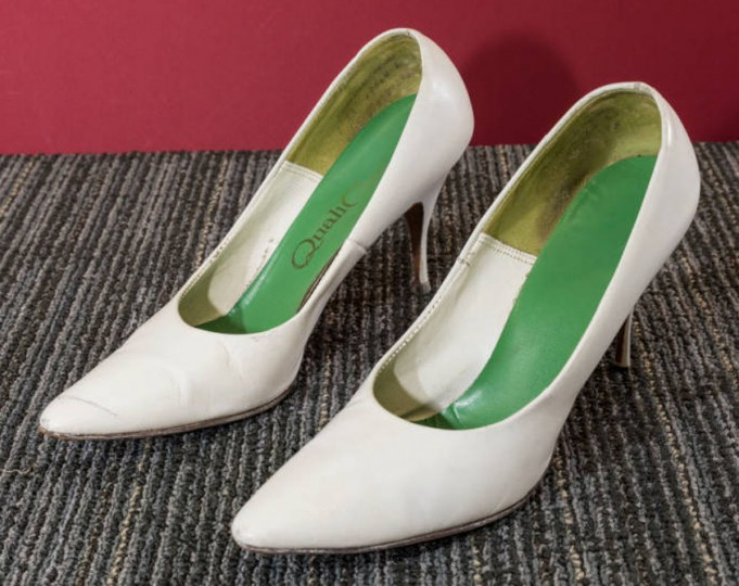White leather stiletto heels with bright green insole, by QualiCraft. Receipt shows they were purchased at Baker's Shoe Store in Perring Plaza on Joppa Road for $8.23. (Photo from the Baltimore Historical Society via Enoch Pratt Library)