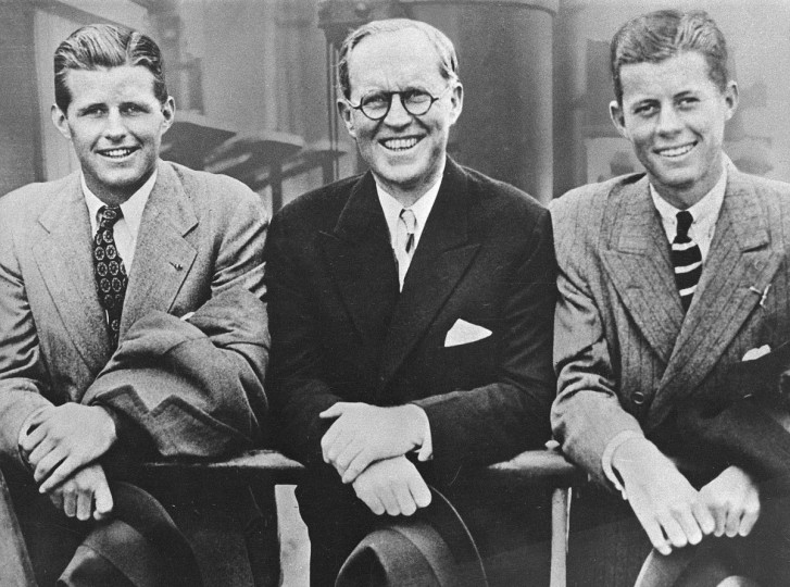 In this 1938 file photo, John F. Kennedy, right, poses aboard an ocean liner with his father Joseph P. Kennedy, center, U.S. Ambassador to Great Britain, and brother Joseph P. Kennedy Jr., left. Monday, May 29, 2017 marks the 100-year anniversary of the birth of John F. Kennedy, who went on to become the 35th President of the United States. (AP Photo, File)