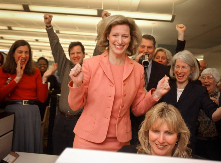 Baltimore Sun reporter Diana Sugg reacts in the newsroom of The Baltimore Sun after it is officially announced that she won a Pulitzer Award for beat reporting in 2003. (LLOYD FOX/Baltimore Sun)