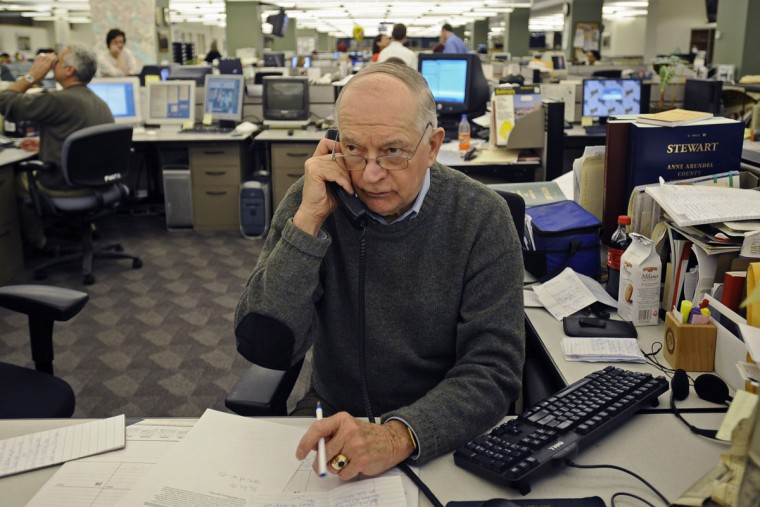 """Baltimore Sun crime reporter Richard Irwin wrote the """"police blotter"""" for Baltimore City and County for 30 years, even before he started working for The Sun. Irwin is pictured calling area police departments in the Baltimore Sun newsroom. (Kenneth K. Lam/Baltimore Sun)"""
