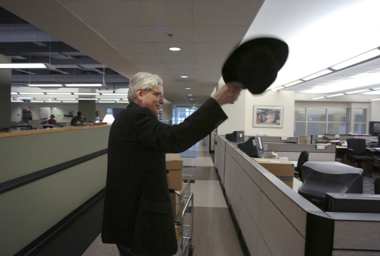 The Baltimore Sun's copy desk chief, John McIntyre, leaves the newsroom with his personal belongings. He was laid off in 2009 as one of 61 cut from the newsroom. McIntyre would later be re-hired by The Sun. (Jerry Jackson/Baltimore Sun)