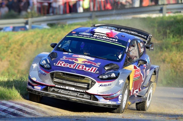French driver Sebastien Ogier and co-driver Julien Ingrassia, also from France, steer their Ford Fiesta WRC in Lousada, on May 18, 2017, during the Super Special opening stage of the Portuguese WRC rally. (Miguel Riopa/AFP/Getty Images)