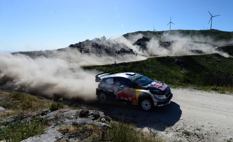 French driver and co-driver, Sebastien Ogier and Julien Ingrassia, steer their Ford Fiesta WRC in Caminha, northern Portugal, on May 19, 2017, during the first stage on the second day of the Portugal WRC rally. (Miguel Riopa/AFP/Getty Images)