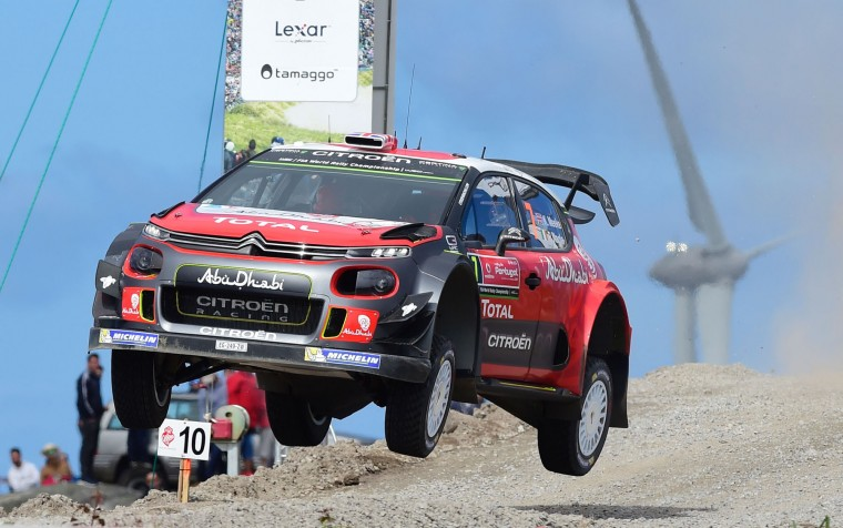 British driver Kris Meeke and Irish co-driver Paul Nagle, steer their Citroen C3 WRC in Viana do Castelo, northern Portugal, on May 19, 2017, during the first stage of the Portugal WRC rally. (Miguel Riopa/AFP/Getty Images)