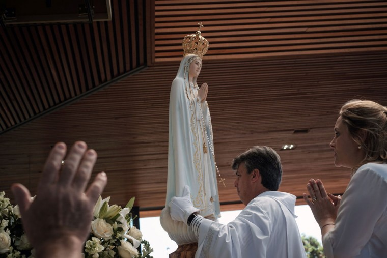 In Brazil, the statue of Our Lady of Fatima is placed during the centenary Mass marking the apparition of the Virgin Mary in Fatima. (YASUYOSHI CHIBA/AFP/Getty Images)
