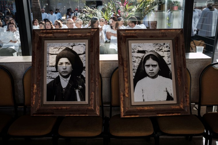 Portraits of child shepherds Jacinta (R) and Francisco Marto are set on chairs in the Chapel of the Apparitions before the centenary Mass in Brazil marking the apparition of the Virgin Mary in Fatima.