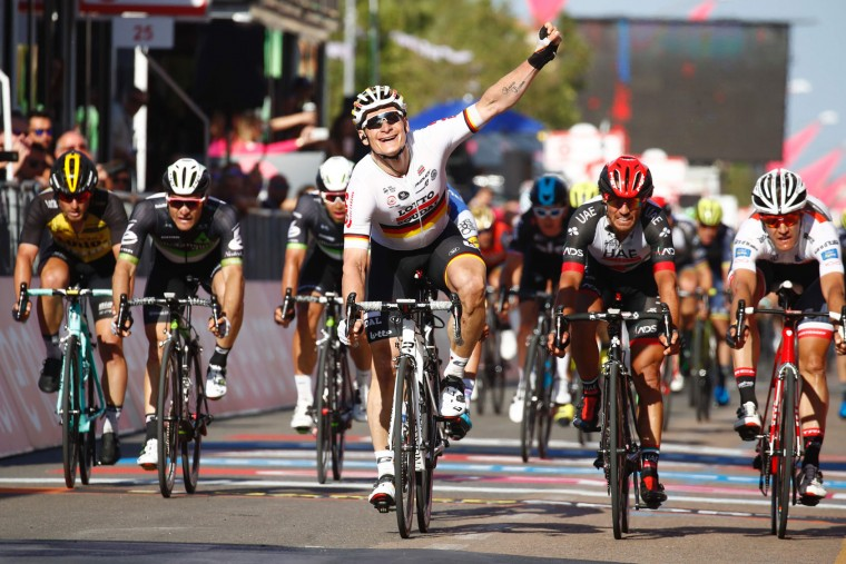 Germany's Andre Greipel (C) of team Lotto-Soudal celebrates as he crosses the finish line to win the second stage of the 100th Giro d'Italia, Tour of Italy, cycling race from Olbia to Tortoli on May 6, 2017 in Sardinia. (Luk Benies/AFP/Getty Images)