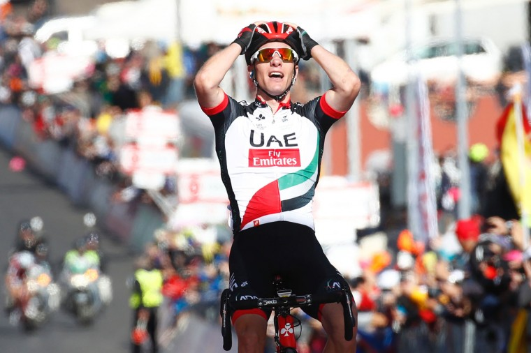 Slovenian Jan Polanc of team UAE celebrates as he crosses the finish line to win the 4th stage of the 100th Giro d'Italia, Tour of Italy, cycling race from Cefalu to Etna volcano, on May 9, 2017 in Sicily. Slovenian Jan Polanc conquered the prestigious Giro d'Italia fourth stage to Mount Etna on Tuesday as Luxembourg's Bob Jungels took the race leader's pink jersey. (Luk Benies/AFP/Getty Images)