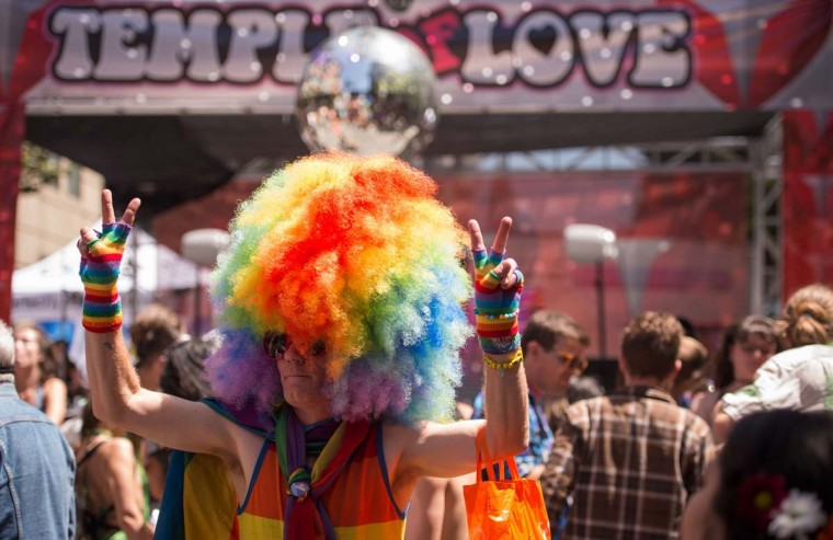 Chad Christiansen dances during the 18th annual How Weird Street Faire in San Francisco, California on May 07, 2017. Several city blocks filled with thousands of people as they partied and danced in costume to electronic music and interacted with street performers and artists. (JOSH EDELSON/AFP/Getty Images)