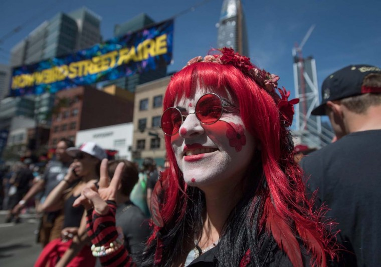Sherry the Clown poses for a photo during the 18th annual How Weird Street Faire in San Francisco, California on May 07, 2017. Several city blocks filled with thousands of people as they partied and danced in costume to electronic music and interacted with street performers and artists. (JOSH EDELSON/AFP/Getty Images)