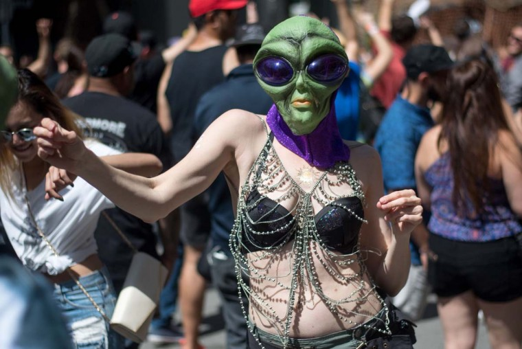 A woman dressed as an alien dances during the 18th annual How Weird Street Faire in San Francisco, California on May 07, 2017. Several city blocks filled with thousands of people as they partied and danced in costume to electronic music and interacted with street performers and artists. (JOSH EDELSON/AFP/Getty Images)