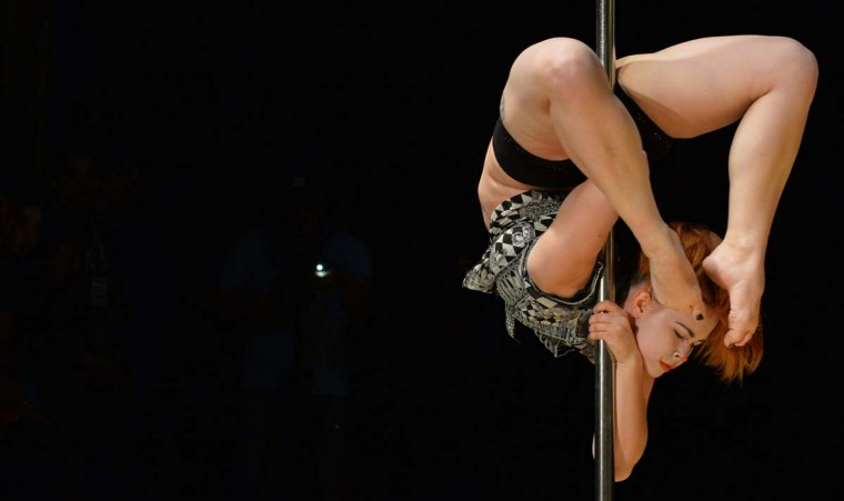 "A participant performs during the ""Kyrgyzstan Pole Sport Championship 2017"" competition in Bishkek late on May 1, 2017. (VYACHESLAV OSELEDKO/AFP/Getty Images)"
