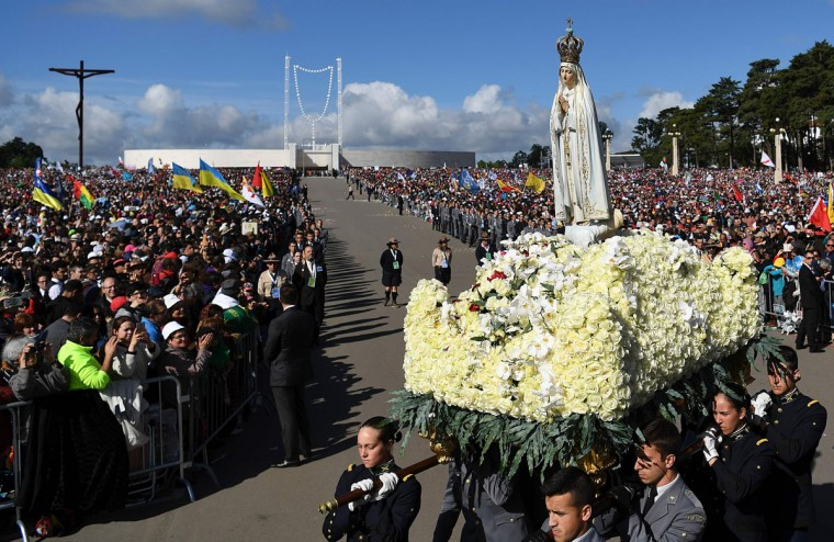 A statue of Our Lady of Fatima is carried to the Chapel of Apparitions after a Mass celebrated by Pope Francis at Fatima shrine, in Portugal. (FRANCISCO LEONG/AFP/Getty Images)
