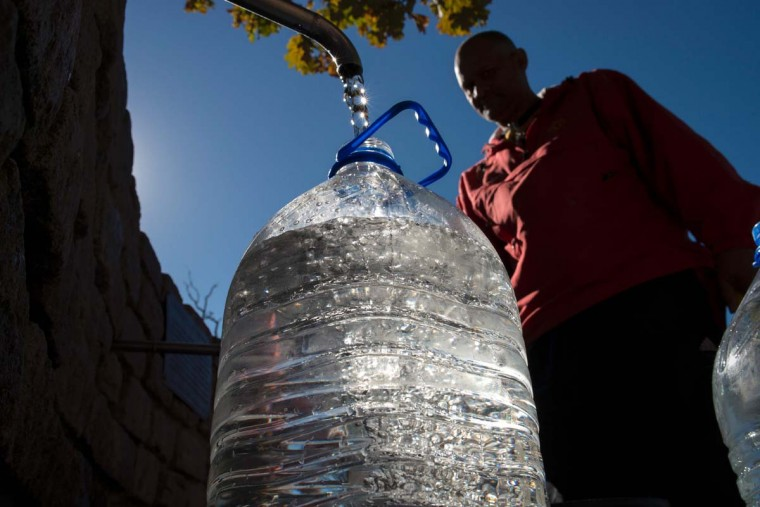 A man collects drinking water from taps that are fed by a spring in Newlands on May 15, 2017, in Cape Town. South Africa's Western Cape region which includes Cape Town declared a drought disaster on May 22 as the province battled its worst water shortages for 113 years. This dam is the main water source for the city of Cape Town, and there is only 10% of it's usual capacity left for human consumption, at the last 10% is not usable, due to the silt content. (RODGER BOSCH/AFP/Getty Images)