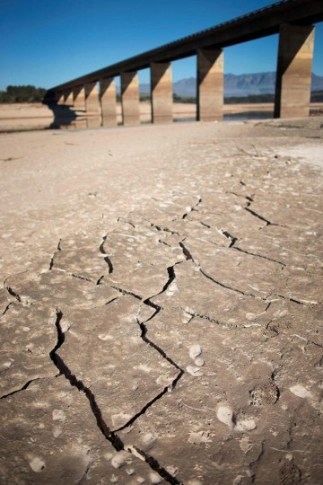 A picture taken on May 10, 2017 shows dry cracked mud staring out at the sky at Theewaterskloof Dam, which has less than 20% of it's water capacity, near Villiersdorp, about 108Km from Cape Town. South Africa's Western Cape region which includes Cape Town declared a drought disaster on May 22 as the province battled its worst water shortages for 113 years. This dam is the main water source for the city of Cape Town, and there is only 10% of it's usual capacity left for human consumption, at the last 10% is not usable, due to the silt content. (RODGER BOSCH/AFP/Getty Images)