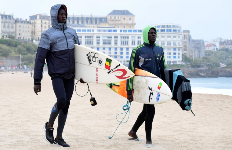 Cheriff Fall of Senegal (L) before the heats 10 - Round 1 on May 22, 2017 in Biarritz, southwestern France, during the 2017 ISA World Surfing Games. The event, gathering athletes from over 40 countries, takes place until May 28. (Franck Fife/AFP/Getty Images)