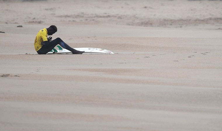 Cheriff Fall of Senegal reacts before during the heats 10 - Round 1 on May 22, 2027 in Biarritz, southwestern France, during the 2017 ISA World Surfing Games. The event, gathering athletes from over 40 countries, takes place until May 28. (Franck Fife/AFP/Getty Images)