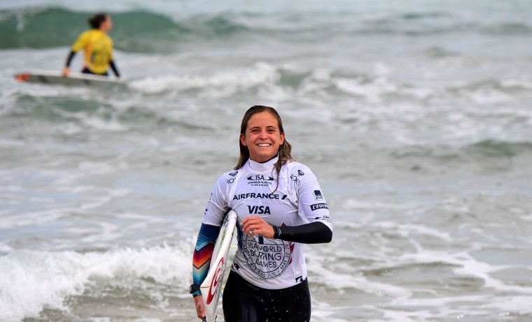 France's Pauline Ado celebrates her win after competing in the 2017 ISA World Surfing Games on May 22, 2027 in Biarritz, southwestern France. France's Pauline Ado scored the best finish of the final on the Grande Plage Beach, ahead of France's Johanne Defay and Costa Rican Leilani McGonagle. (Franck Fife/AFP/Getty Images)