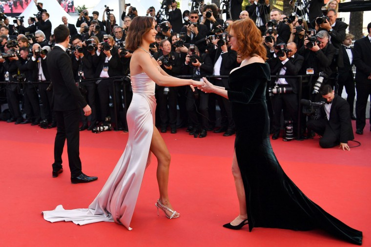 US model Bella Hadid (C) is greeted by US actress Susan Sarandon as she arrives on May 17, 2017 for the screening of the film 'Ismael's Ghosts' (Les Fantomes d'Ismael) during the opening ceremony of the 70th edition of the Cannes Film Festival in Cannes, southern France. (Alberto Pizzoli/AFP/Getty Images)