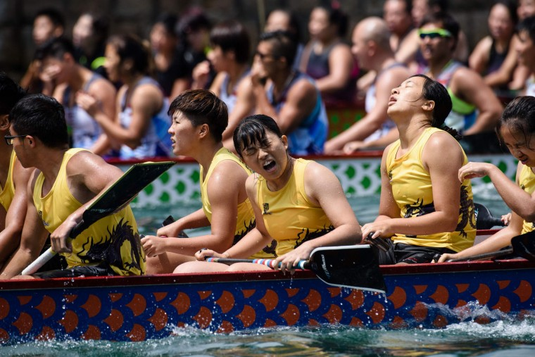 Competitors react as they take part in the annual dragon boat race held to celebrate the Tuen Ng festival in Hong Kong on May 30, 2017. (Anthony Wallace/AFP/Getty Images)