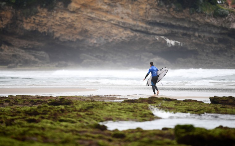 A surfer arrives for heats - Round 1 on May 23, 2017 in Biarritz, southwestern France, during the 2017 ISA World Surfing Games. The event runs until May 28. (Franck Fife/AFP/Getty Images)