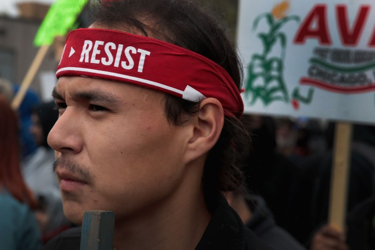 Demonstrators participate in a May Day march to downtown on May 1, 2017 in Chicago, Illinois. May Day, also known as International Worker's Day, originated in Chicago when labor leaders staged a series of rallies and marches in May of 1886 to demand an eight-hour work day. (Photo by Scott Olson/Getty Images)