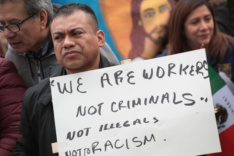 Demonstrators participate in a May Day rally in Union Park before marching to downtown on May 1, 2017 in Chicago, Illinois. May Day, also known as International Worker's Day, originated in Chicago when labor leaders staged a series of rallies and marches in May of 1886 to demand an eight-hour work day. (Photo by Scott Olson/Getty Images)