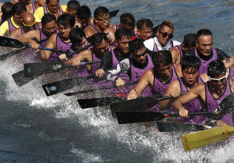 Participants compete in a dragon boat race in Hong Kong, Tuesday, May 30, 2017, as part of celebrations marking the Chinese Dragon Boat Festival, held throughout the islands. (AP Photo/Vincent Yu)