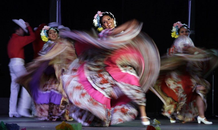 FILE--In this May 5, 2015, file photo, dancers from Jalisco, Mexico, perform during Cinco de Mayo celebrations in Portland, Ore. President Donald Trump's immigration policies and rhetoric are leaving some Mexican Americans and immigrants feeling at odds with a day they already thought was appropriated by beer and liquor companies, event promoters and local bars. (AP Photo/Don Ryan, file)