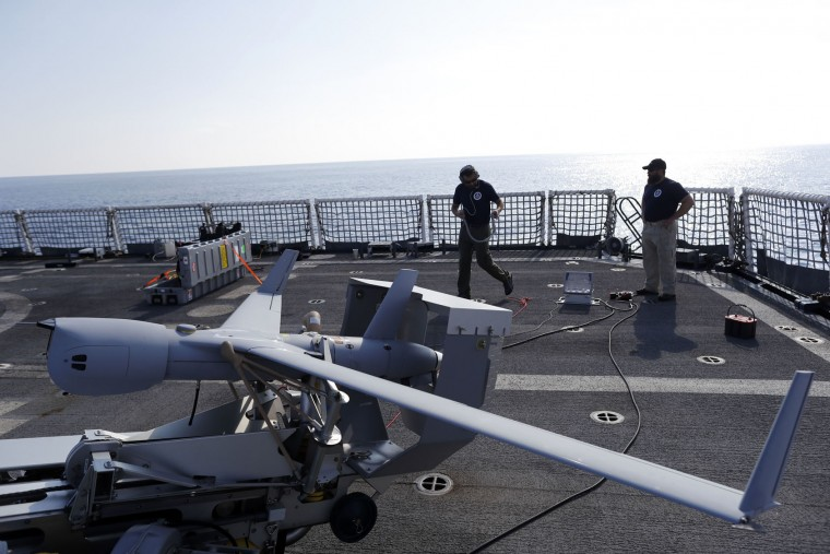 In this Saturday, Feb. 25, 2017 photo, technicians prepare the ScanEagle unmanned aerial vehicle prior to take off from the flight deck of the U.S. Coast Guard cutter Stratton somewhere in the eastern Pacific Ocean. The Associated Press spent two weeks in February and March aboard the Stratton, the most advanced ship in the Coast Guard fleet, as 100-plus crew members patrolled the eastern Pacific, through which about 70 percent of the cocaine consumed in the U.S. passes. (AP Photo/Dario Lopez-Mills)