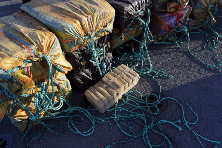 In this Feb. 23, 2017 photo, the crew from the U.S. Coast Guard cutter Stratton gather bales of cocaine that were seized from a small fishing boat in Pacific Ocean, hundreds of miles south of the Guatemala-El Salvador border. More than a dozen countries in Central and South America have essentially outsourced their drug-interdiction efforts to the U.S. (AP Photo/Dario Lopez-Mills)
