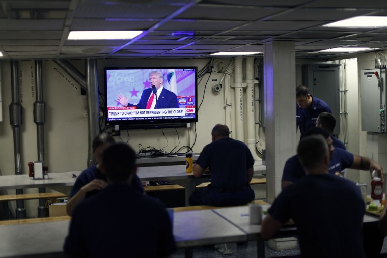 In this Friday, Feb. 24, 2017 photo, a broadcast of President Trump speaking live at the Conservative Political Action Conference is shown on TV while lunch is being served aboard the U.S. Coast Guard cutter Stratton while it is sailing in the eastern Pacific Ocean. The Stratton's biggest bust, a Coast Guard record, came in 2015, when it found more than 16,000 pounds of cocaine worth millions, before the craft, a hard-to-detect semi-submersible vessel, sank with some of its cargo still aboard. (AP Photo/Dario Lopez-Mills)