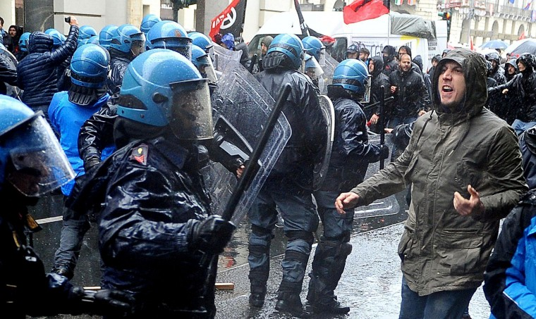 Protesters clash with riot police as they attempt to force their way closer to a Labor Day march, in Turin, Italy, Monday, May 1, 2017. (Alessandro Di Marco/ANSA via AP)