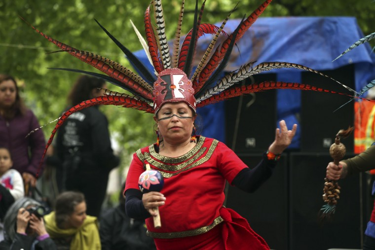 A group dances during a May Day rally and march at Shemanski Park in downtown Portland, Ore., Monday, May 1, 2017. Some 200 people including some families with children in Portland joined many thousands of others across the country in pro-labor, pro-immigration and anti-Donald Trump rallies on May Day. (Stephanie Yao Long/The Oregonian via AP)
